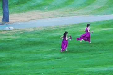 Bridesmaids running at King Valley Golf course. Fall Wedding photography session